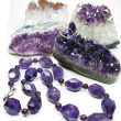 Amethyst geode geological crystals and jewelery beads — Stock Photo #24457885