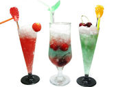 Three alcohol liquer cocktail drinks with fruit — Stock Photo