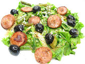 Greek hot salad with sausage and olives — Stock Photo