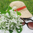 Bouquet of lily of the valley flowers sunglasses and hat — ストック写真