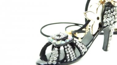Gold pendant black shoe with diamond jewelery crystals — Stock Video