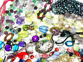 Crystals beads jewellery as fashion background — Stock Photo