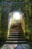 Castle steps leading to the light — Stock Photo