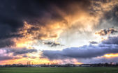 Rainclouds and sunset — Stock Photo