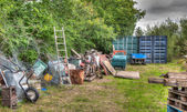Rubbish in garden — Stock Photo
