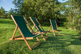 Deckchairs at sunset — Stock Photo
