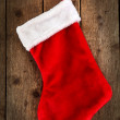 Red sock of gifts - Stock fotografie