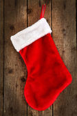 Red sock of gifts — Stock Photo