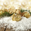 Snow decoration with gold color - Stock Photo