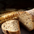 Bread on wooden table — Stock Photo