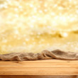 Table with golden background — Stock Photo