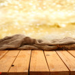 Stock Photo: Table with golden background