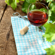 Wine and leaves — Stock Photo