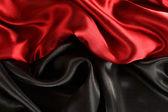 Achtergrond van rode en zwarte gordijnen — Stockfoto