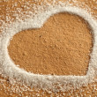 Heart from sugar in the sand — Stock fotografie