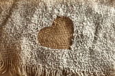 Heart in the flour in the bag — Stock Photo