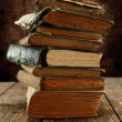 Old books piled up on rustic table — Stock Photo