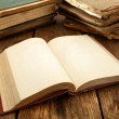 Open book on rustic table - Stock Photo