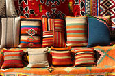 Background of multi-colored pillows on display — Stock Photo