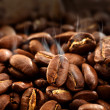 Smoke on coffee beans — Stock Photo #18601393