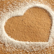 Heart and brown paper with sugar — Stock Photo #18643079