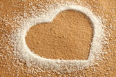 Heart and brown paper with sugar — Stock Photo