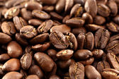 Smoke on coffee beans — Stock Photo
