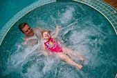 Father with daughter 19 months old are in Jacuzzi — Stock Photo