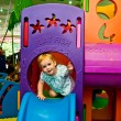 Girl 1,5 years old has fun in game complex — Stock Photo #12325142