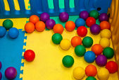 Plastic balls of different colors on the playground — 图库照片
