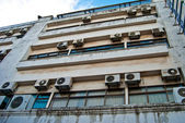 Wall of the building with outer blocks of air-conditioners — Stock Photo