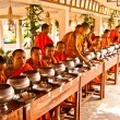 Buddhist monks are in expectation of food and money offerings - Stock fotografie