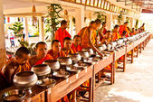 Buddhist monks are in expectation of food and money offerings — Stock Photo
