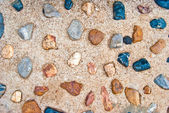 Stenen in het beton — Stockfoto