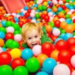 Small girl has fun in the dry pool — Stock Photo