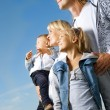 Healthy Family Outdoor. Happy Mother And Father With Kids Over B — Stock Photo #10676207