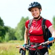 Happy Young Woman riding bicycle outside. Healthy Lifestyle - 图库照片