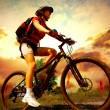 Stock Photo: Happy Young Woman riding bicycle outside. Healthy Lifestyle