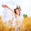 Beautiful Happy Girl on the Wheat Field — Stock Photo #12800445