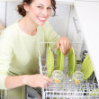 Dishwasher. Young woman in the Kitchen doing Housework. Wash-up - Foto de Stock  