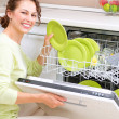 Dishwasher. Young woman in the Kitchen doing Housework. Wash-up - 图库照片