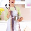 Young woman cooking healthy food — Stock Photo #12800575