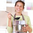 Young woman cooking healthy food — Stock Photo