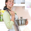 Young woman cooking healthy food — Stock Photo #12800637