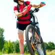 Happy Young Woman riding bicycle outside. Healthy Lifestyle  — Stock Photo #12800700
