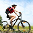 Happy Young Woman riding bicycle outside. Healthy Lifestyle — Stock Photo #12800734