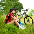 Happy Young Woman riding bicycle outside. Healthy Lifestyle  — Zdjęcie stockowe