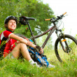 Happy Young Woman riding bicycle outside. Healthy Lifestyle - Stock Photo