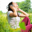 Beautiful Young Woman with Headphones Outdoors. Enjoy Music  — 图库照片