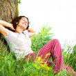 Beautiful Young Woman Relaxing outdoors. Nature — Stok fotoğraf